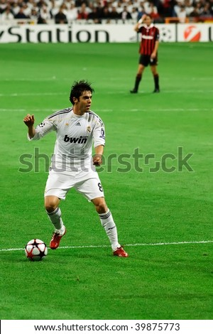 MADRID - OCT 21: Real Madrid's Kaka looks for a teammate during their 2-3 loss against AC Milan in Champions League group stage action October 21, 2009 in Madrid, Spain. - stock photo
