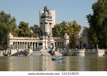 MADRID - OCTOBER 18: People enjoy sunny day at Buen Retiro Park around Alfonso XII monument on October 18, 2013 in Madrid, Spain. The Buen  Retiro Park  is the one of the largest parks of the city.