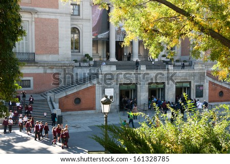 MADRID - OCTOBER 18: Spanish schoolchildren and people wait in line at the Prado ticket office on October 18, 2013 in Madrid, Spain. The Museum is the main Spanish national art museum.  - stock photo