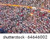 MADRID - OCTOBER 1: The huge crowd jammed in the famous Plaza de Toros watches the bullfight on October 1, 2010 in Madrid, Spain. - stock photo