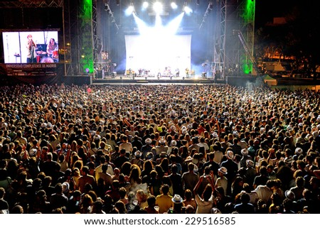 MADRID - SEP 13: A venue full of people watching a concert at Dcode Festival on September 13, 2014 in Madrid, Spain. - stock photo