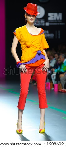 MADRID -Â?Â? SEPTEMBER 17: A model walks on the Agatha Ruiz de la Prada catwalk during the Cibeles Madrid Fashion Week runway on September 17, 2011 in Madrid, Spain. - stock photo
