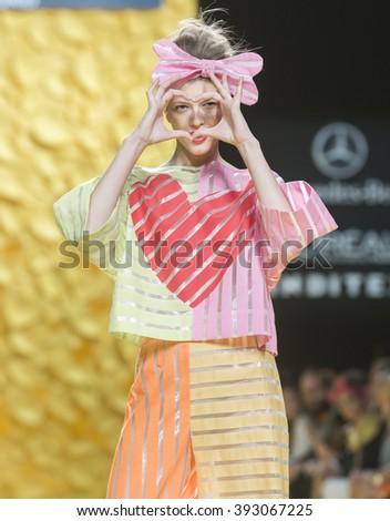MADRID - SEPTEMBER 18: a model walks on the Agatha Ruiz de la Prada catwalk during the Mercedes-Benz Fashion Week Madrid Spring/Summer 2016 runway on September 18, 2015 in Madrid.  - stock photo
