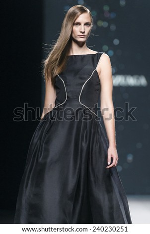 MADRID - SEPTEMBER 14: a model walks on the Amaya Arzuaga catwalk during the Mercedes-Benz Fashion Week Madrid Spring/Summer 2015 runway on September 14, 2014 in Madrid.