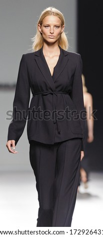 MADRID - SEPTEMBER 14: A model walks on the Angel Schlesser catwalk during the Cibeles Madrid Fashion Week runway on September 14, 2013 in Madrid.