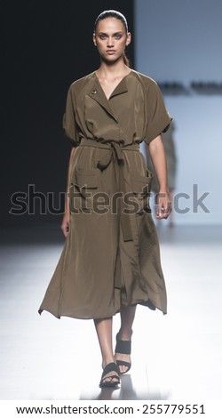 MADRID - SEPTEMBER 12: a model walks on the Angel Schlesser catwalk during the Mercedes-Benz Fashion Week Madrid Spring/Summer 2015 runway on September 12, 2014 in Madrid.  - stock photo