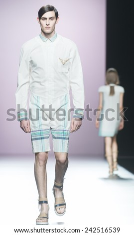MADRID - SEPTEMBER 12: a model walks on the Devota & Lomba catwalk during the Mercedes-Benz Fashion Week Madrid Spring/Summer 2015 runway on September 12, 2014 in Madrid.