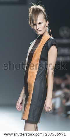 MADRID - SEPTEMBER 13: a model walks on the Etxebarria catwalk during the Mercedes-Benz Fashion Week Madrid Spring/Summer 2015 runway on September 13, 2014 in Madrid.  - stock photo