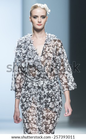 MADRID - SEPTEMBER 13: a model walks on the Juana Martin catwalk during the Mercedes-Benz Fashion Week Madrid Spring/Summer 2015 runway on September 13, 2014 in Madrid.  - stock photo