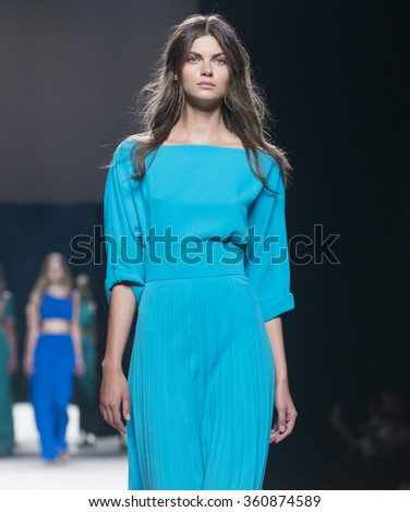 MADRID - SEPTEMBER 19: a model walks on the Juanjo Oliva catwalk during the Mercedes-Benz Fashion Week Madrid Spring/Summer 2016 runway on September 19, 2015 in Madrid.  - stock photo