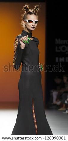 MADRID � SEPTEMBER 04: A model walks on the Maria Ke Fisherman catwalk during the Cibeles Madrid Fashion Week runway on September 04, 2012 in Madrid. - stock photo