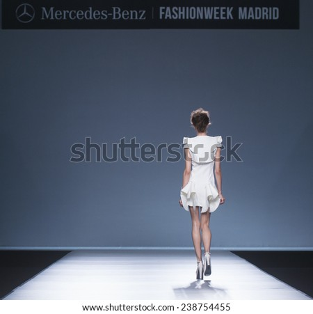 MADRID - SEPTEMBER 13: a model walks on the Maya Hansen catwalk during the Mercedes-Benz Fashion Week Madrid Spring/Summer 2015 runway on September 13, 2014 in Madrid.  - stock photo