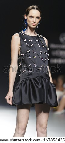 MADRID - SEPTEMBER 16: A model walks on the Moises Nieto catwalk during the Cibeles Madrid Fashion Week runway on September 16, 2013 in Madrid.