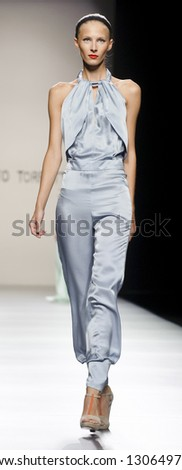 MADRID � SEPTEMBER 02: A model walks on the Roberto Torretta catwalk during the Cibeles Madrid Fashion Week runway on September 02, 2012 in Madrid.