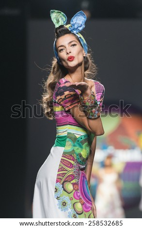 MADRID - SEPTEMBER 11: brazilian model Alessandra Ambrosio walks on the Desigual catwalk during the Mercedes-Benz Fashion Week Madrid Spring/Summer 2015 runway on September 11, 2014 in Madrid.  - stock photo