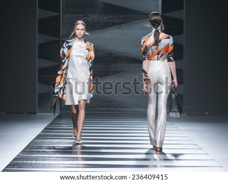 MADRID - SEPTEMBER 12: models walking on the Juanjo Oliva catwalk during the Mercedes-Benz Fashion Week Madrid Spring/Summer 2015 runway on September 12, 2014 in Madrid.  - stock photo