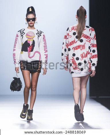 MADRID - SEPTEMBER 15: models walking on the Maria Escote catwalk during the Mercedes-Benz Fashion Week Madrid Spring/Summer 2015 runway on September 15, 2014 in Madrid.  - stock photo