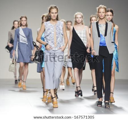 MADRID - SEPTEMBER 15: Models walking on the Rabaneda catwalk during the Cibeles Madrid Fashion Week runway on September 15, 2013 in Madrid.  - stock photo