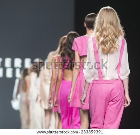 MADRID - SEPTEMBER 13: models walking on the Teresa Helbig catwalk during the Mercedes-Benz Fashion Week Madrid Spring/Summer 2015 runway on September 13, 2014 in Madrid.