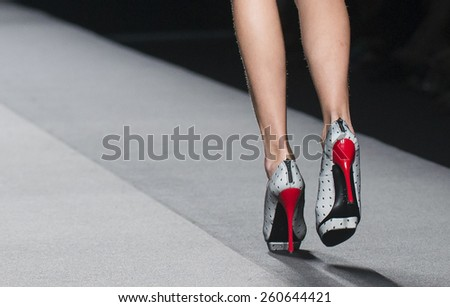MADRID - SEPTEMBER 14: shoes details on the Amaya Arzuaga catwalk during the Mercedes-Benz Fashion Week Madrid Spring/Summer 2015 runway on September 14, 2014 in Madrid.  - stock photo