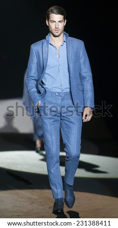 MADRID - SEPTEMBER 12: spanish model Antonio Navas walks on the Roberto Verino catwalk during the Mercedes-Benz Fashion Week Madrid Spring/Summer 2015 runway on September 12, 2014 in Madrid.  - stock photo