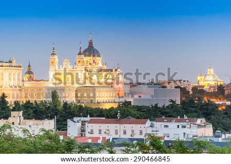 Madrid Skyline at dusk with the Royal Palace and the Almudena Cathedral  - stock photo