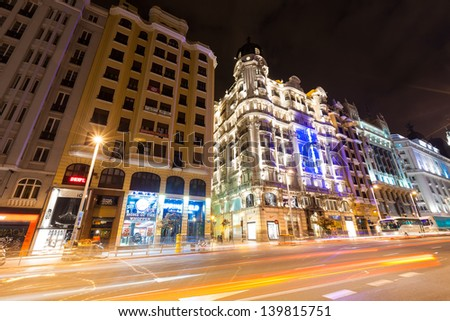 MADRID, SPAIN - APRIL 26:  Evening view of Gran Via street in April 26, 2013 in Madrid, Spain. Gran Via one of broadest and most important avenues at city and one of centre of nightlife