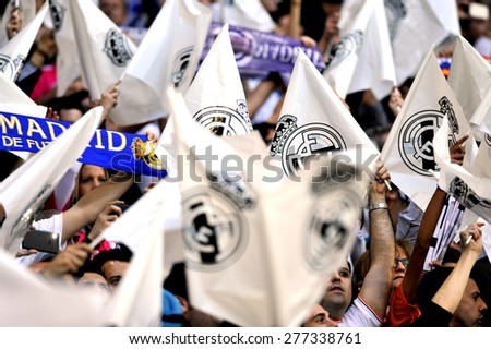 MADRID, SPAIN -  April 22nd, 2014 :  thousands of white flags of REAL MADRID fans during the UEFA Champions League match vs ATLETICO at Santiago Bernabeu Stadium  - stock photo