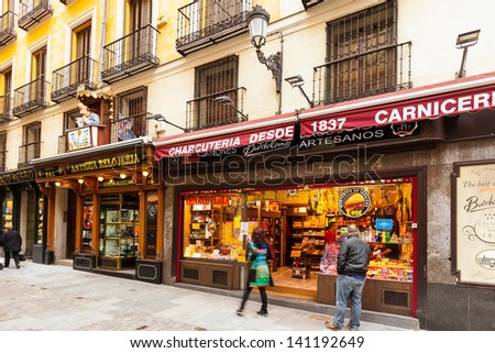 MADRID, SPAIN - APRIL 26: Spanish street with few shop in April 26, 2013 in Madrid, Spain. It is old centre of capital city