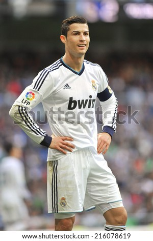MADRID, SPAIN - April 20th, 2013 : Portuguese football superstar of Real Madrid CRISTIANO RONALDO in action during La Liga match at Santiago Bernabeu Stadium.  - stock photo