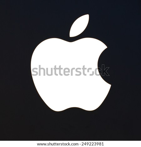 MADRID, SPAIN - AUGUST 20, 2014: Apple Sign Close Up. Is an American corporation that designs and sells consumer electronics, computer software and personal computers. - stock photo