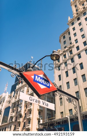 MADRID, SPAIN - AUGUST 1, 2016: Metro sign in Gran Via Street in Madrid, Spain. Madrid is the capital and largest city of Spain.