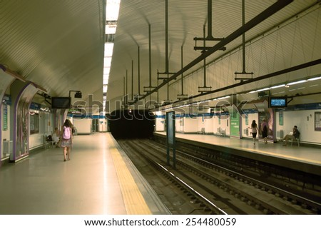 MADRID, SPAIN - AUGUST 9: Metro station in Madrid. Annually Madrid subway transports more than 600 million people on August 9, 2014 in Madrid, Spain - stock photo