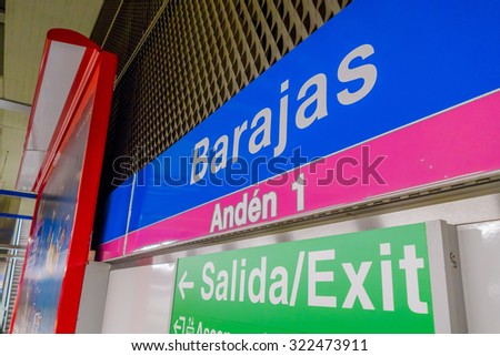 MADRID, SPAIN- 8 AUGUST, 2015: Signs of location and emergency exit at the train station Barajas Airport..