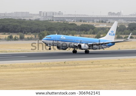 MADRID, SPAIN - AUGUST 8th 2015: Aircraft -Boeing 737-8K2-, of -KLM- airline, is taking off from Madrid-Barajas -Adolfo Suarez- airport, on August 8th 2015.
