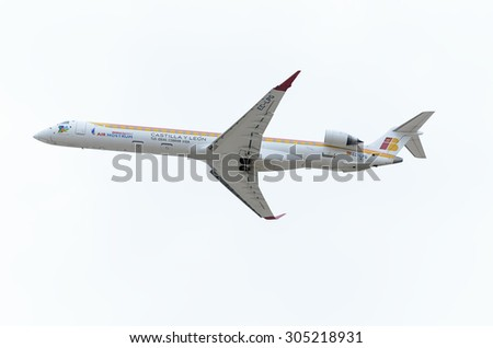 MADRID, SPAIN - AUGUST 8th 2015: Aircraft -Bombardier Canadair CRJ-1000-, of -Air Nostrum- airline, is taking off from Madrid-Barajas -Adolfo Suarez- airport, on August 8th 2015.