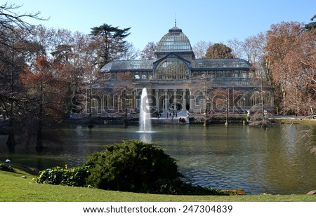 MADRID, SPAIN - DECEMBER 24: Crystal Palace in El Retiro Park in Madrid, Spain on December 24, 2014. Crystal Palace is a metal and glass structure, built in 1887 and has an area of 750 m2. - stock photo