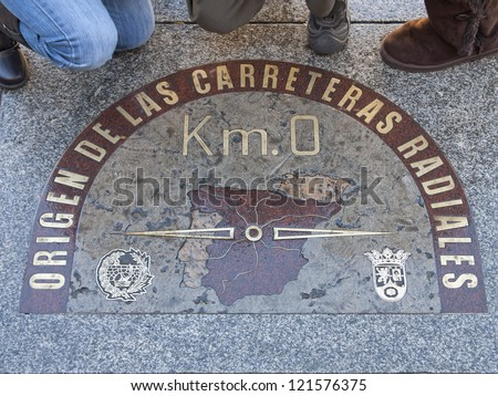 MADRID, SPAIN - DECEMBER 8: Kilometre zero sign on December 8, 2012 in Madrid, Spain. The sign in on the pavement on Puerta del Sol square. It is a starting point for measuring distance in Spain.
