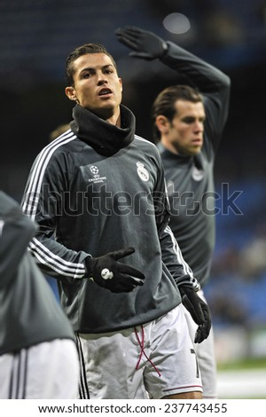 MADRID, SPAIN - December 12th, 2014 : CRISTIANO RONALDO and GARETH BALE of Real Madrid warm up during the UEFA Champions League 2014 match at Santiago Bernabeu Stadium.  - stock photo