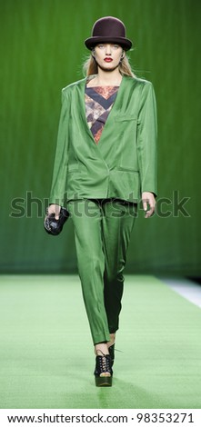 MADRID, SPAIN -  FEBRUARY 04: A model walks on the Martin Lamothe catwalk during the Mercedes-Benz Fashion Week Madrid runway on February 04, 2012 in Madrid, Spain. - stock photo