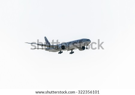 MADRID, SPAIN - FEBRUARY 08th 2015: Aircraft -Boeing 777-3DZ-, of -Qatar Airways- airline, landing on Madrid-Barajas airport, on February 8th 2015. - stock photo