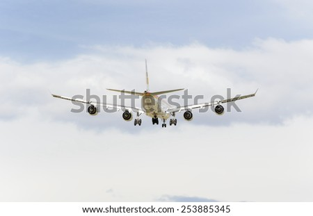 MADRID, SPAIN - FEBRUARY 14th 2015: Airplane -Airbus A340-600-, of -Iberia- airline, landing on Madrid-Barajas -Adolfo Suarez- airport, on February 14th 2015. - stock photo
