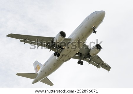 MADRID, SPAIN - FEBRUARY 14th 2015: Airplane -Airbus A320-, of -Iberia- airline, landing on Madrid-Barajas airport, on February 14th 2015. - stock photo