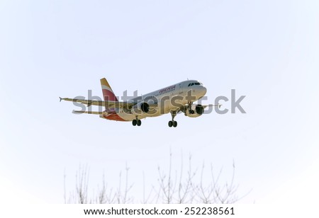 MADRID, SPAIN - FEBRUARY 08th 2015: Airplane -Airbus A320-, of the -Iberia- airline, landing on Madrid-Barajas airport, on February 8th 2015.