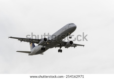 MADRID, SPAIN - FEBRUARY 14th 2015: Airplane -Airbus 321-200-, of -Lufthansa- airline, landing on Madrid-Barajas -Adolfo Suarez- airport, on February 14th 2015. - stock photo