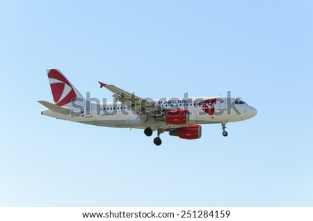 MADRID, SPAIN - FEBRUARY 08th 2015: An airplane -Airbus A319-, of the -Czech- airline, landing on Madrid-Barajas airport, on February 8th 2015. - stock photo
