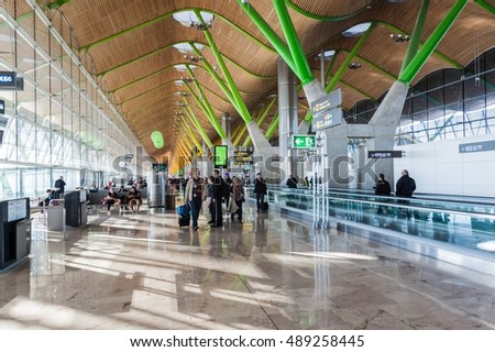 MADRID, SPAIN - JAN 26, 2015: Interior of a terminal in Adolfo Suarez Madrid Barajas Airport.