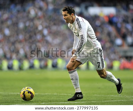 MADRID, SPAIN - Januar 10th, 2015 : CRISTIANO RONALDO of Real Madrid in action during La Liga match against ESPANYOL at Santiago Bernabeu Stadium  - stock photo