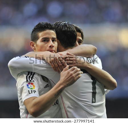 MADRID, SPAIN - Januar 10th, 2015 :  JAMES RODRIGUEZ of  REAL MADRID scores against ESPANYOL and celebrates with RONALDO 1-0 during the spanish La liga match at Santiago Bernabeu Stadium  - stock photo