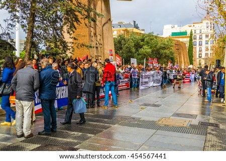 MADRID, SPAIN, JANUARY 10, 2016: people in madrid are protesting against barnevernet organization which is accused of abusing parental rights in norway. - stock photo